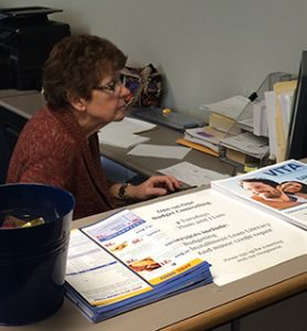 A Woman Volunteering as a Receptionist