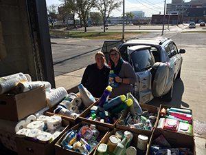 Volunteers Handing Out Supplies