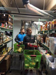 Teenagers Sorting Food into Baskets