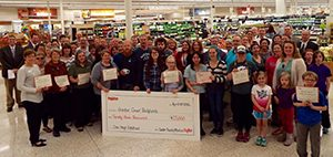 Group of People Holding a Grant Check