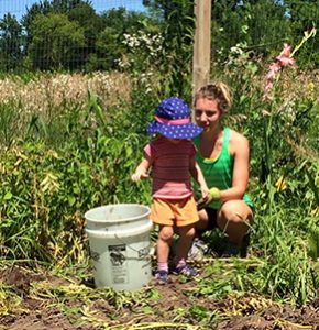Mom and Child Volunteer in the Garden